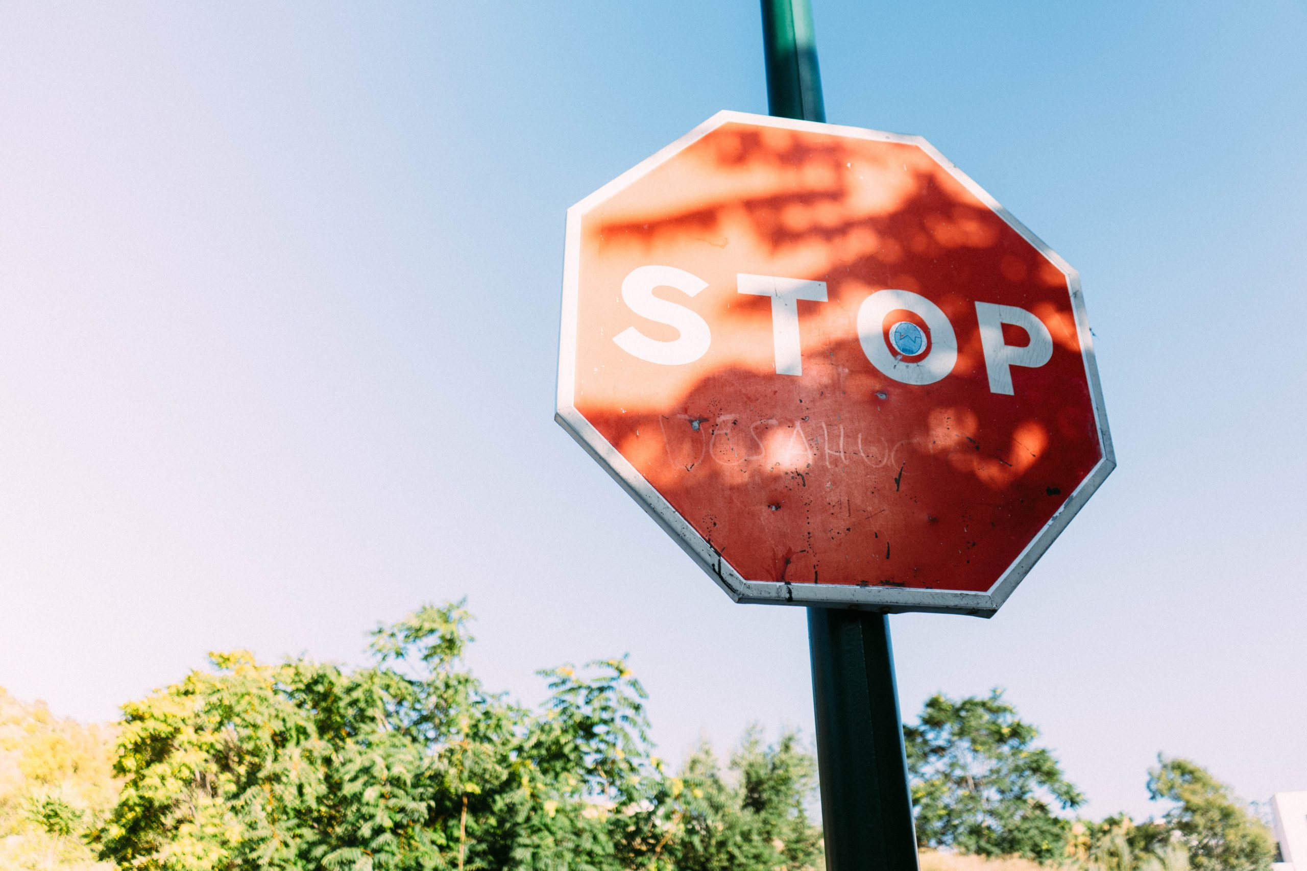red-stop-signage-under-clear-blue-sky-1292296