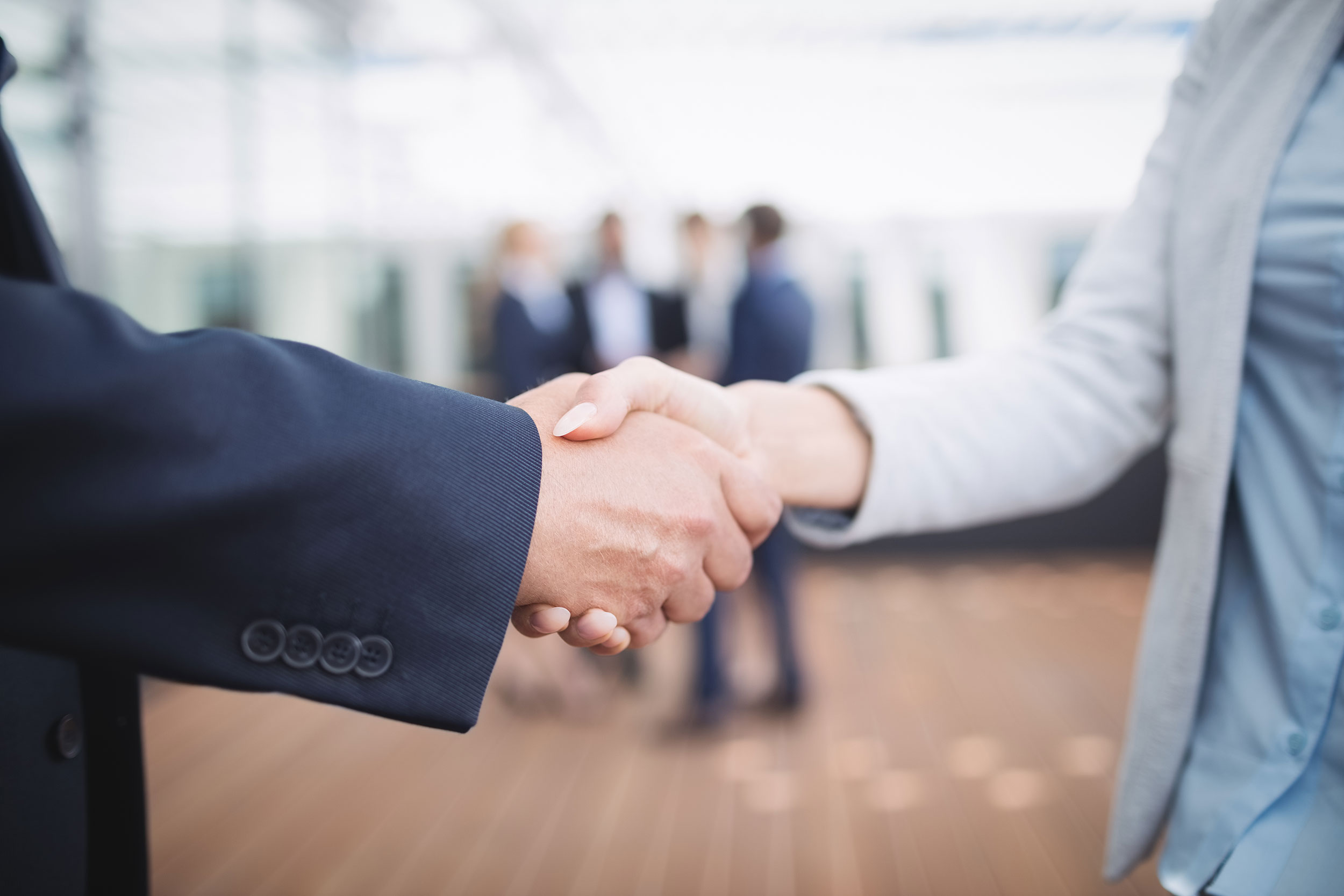 businesspeople-shaking-hands